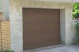 Секционные гаражные ворота Хёрманн цвет тёмный дуб