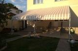 Солнцезащитная система - ткань в положении открыто.